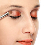 Woman applying eye shadows Stock Photo