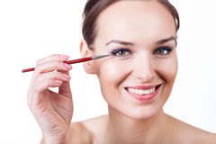 Woman applying eyeliner with brush Royalty Free Stock Photo