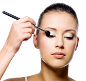 Woman applying eyeshadow with brush Royalty Free Stock Images