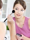 Woman applying eyeshadow with brush Royalty Free Stock Photo