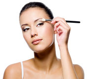 Woman applying eyeshadow with brush Royalty Free Stock Image