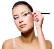 Woman applying eyeshadow with brush Royalty Free Stock Image