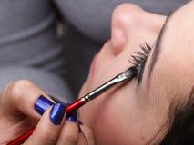 Woman applying eyeshadow makeup brush Royalty Free Stock Image