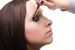 Woman applying eyeshadow makeup brush Stock Photos