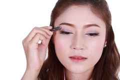 Woman applying eyeshadow powder Stock Photo