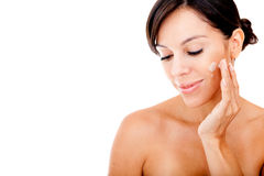 Woman applying face cream Stock Photo