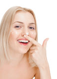 Woman applying face cream Stock Image