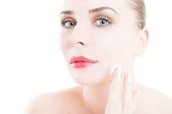 Woman applying face cream on skin care concept Stock Photos