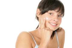 Woman applying facial cream Royalty Free Stock Images