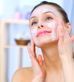 Woman Applying Facial Mask Royalty Free Stock Image