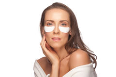 Woman applying facial mask Royalty Free Stock Photos