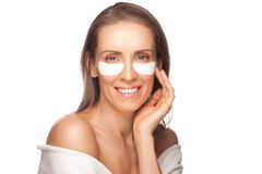 Woman applying facial mask Stock Photo