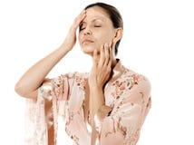 Woman applying facial mask with eyes close Royalty Free Stock Photos