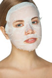 Woman applying facial mask Royalty Free Stock Images