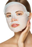 Woman applying facial mask Royalty Free Stock Photography