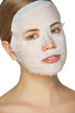Woman applying facial mask Stock Photos
