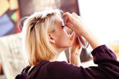 Woman applying false lashes Stock Photos