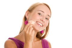 Woman applying foundation Royalty Free Stock Image