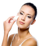 Woman applying foundation on face Stock Photography