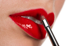 Woman applying glossy red lipstick Royalty Free Stock Photos