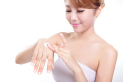 Woman applying hand cream Stock Image