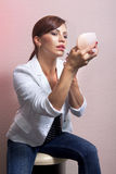 Woman applying her make-up l Royalty Free Stock Image