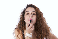 Woman applying lipstick. Sensual young woman applying lipstick (isolated on gray Royalty Free Stock Images