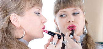 Woman applying lipstick Royalty Free Stock Image