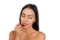Woman applying lipstick royalty free stock photo