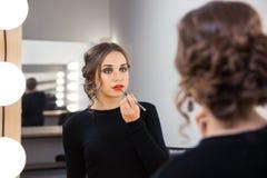 Woman applying lipstick on her lips Royalty Free Stock Photo