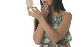 Woman applying lipstick herself Stock Photography