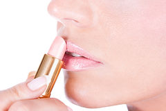 Woman applying lipstick on lips Royalty Free Stock Photos