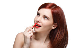 Woman applying lipstick for lips. Stock Photography