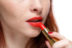 Woman applying lipstick for lips. Stock Image