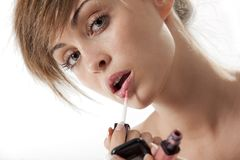 Woman applying liquid glossy lipstick Stock Photos