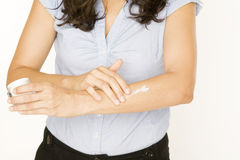 Woman Applying Lotion On Her Hands Royalty Free Stock Photography