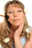 Woman applying make-up Stock Photos