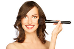 Woman applying make-up Stock Photography