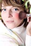 Woman applying make-up. Closeup portrait of attractive young woman applying make-up Royalty Free Stock Photography