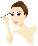 Woman Applying Make-up Royalty Free Stock Photography