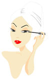 Woman Applying Make-up Royalty Free Stock Photo