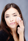 Woman applying make up Stock Photo