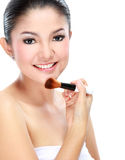 Woman applying make up Stock Photos