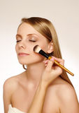 Woman applying make up. Royalty Free Stock Photo
