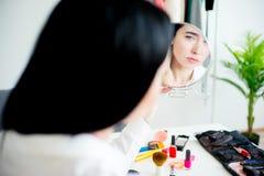 Woman applying make up Stock Image