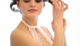 Woman applying make-up indoors stock footage