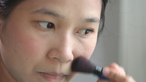 Woman applying make up by rouge, brusher stock footage