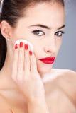 Woman applying make up with sponge Royalty Free Stock Image