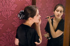 WOMAN APPLYING MAKEUP Stock Photos