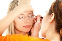Woman applying makeup Royalty Free Stock Photo